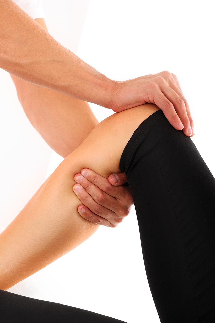 physical therapist working on knee injury